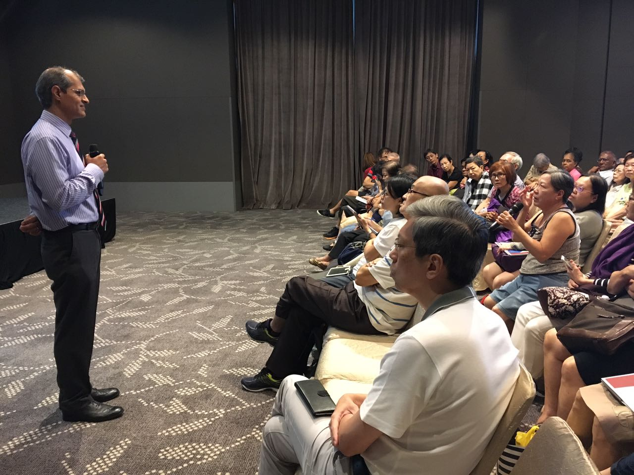 """Dr Ajeet Madhav Wagle answering a question from a participant during the """"Better Health, Living Well"""" free public forum on 24 June 2017 organised by Farrer Park Hospital."""