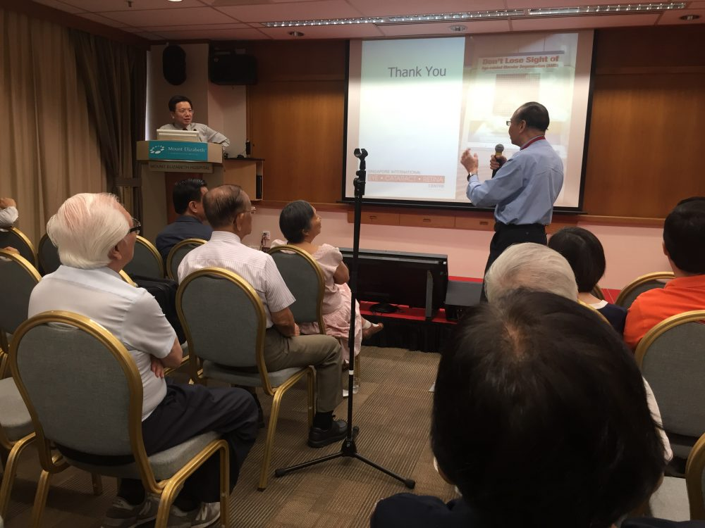 """Dr Au Eong Kah Guan addressing questions from plastic surgeon Dr George Wong after his talk on """"Age-related Macular Degeneration: Current Concepts & Management"""" at Mount Elizabeth Hospital on 18 August 2017."""