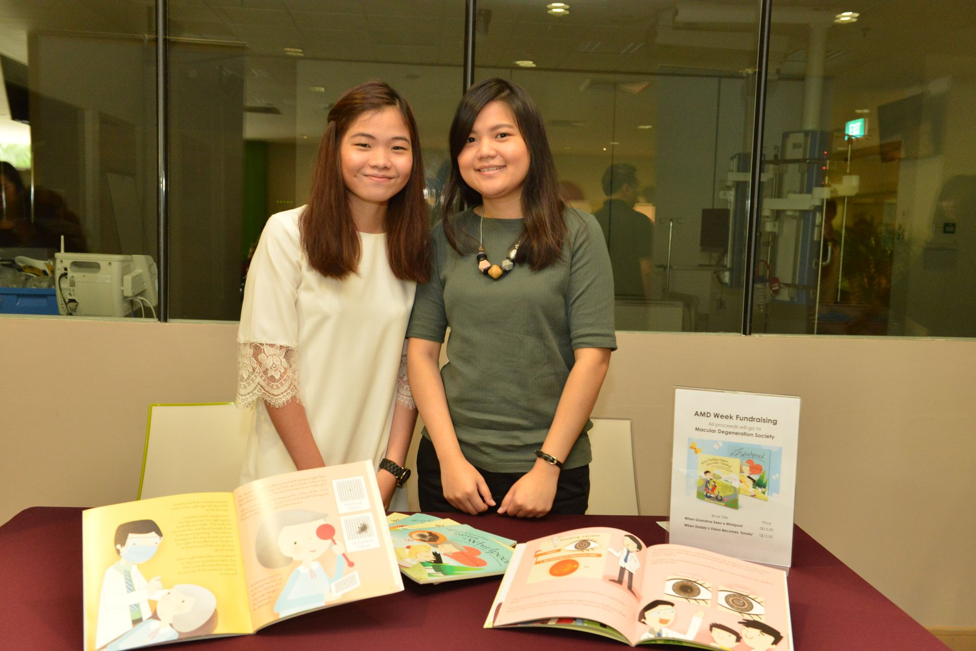 (L-R) Optometrists Ng Shu Yi and Olga Aprianti Lee fund raising for the Macular Degeneration Society at the launch of Awareness of Macular Diseases Week 2017 in Khoo Teck Puat Hospital on 16 September 2017.