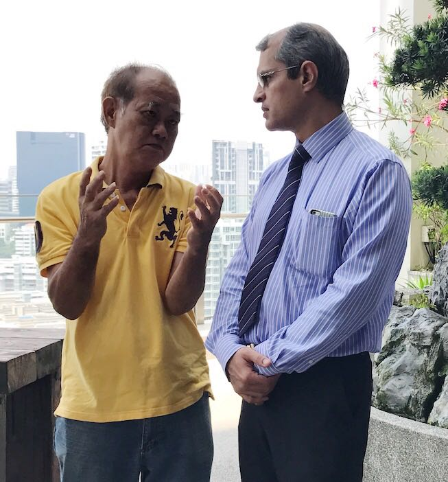 """Patient Mr Lee Geok Kow (L) chatting with his surgeon Dr Ajeet Madhav Wagle during a """"Thank You"""" lunch meeting on 26 October 2017."""