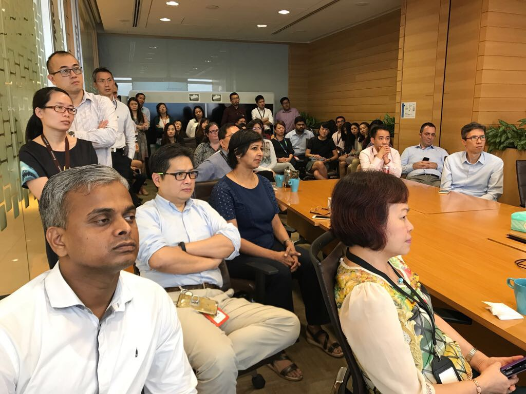 Staff from Novartis (Singapore) Pte Ltd listening attentively to Dr Au Eong Kah Guan's lecture on World Sight Day on 12 October 2017.