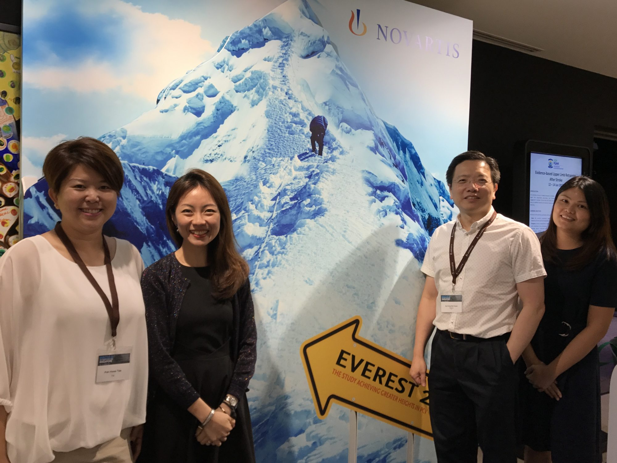 Dr Au Eong Kah Guan (third from left) with (L-R) Ms Sandy Tan, Ms Jacqueline Tan and Ms Joelle Ang from Novartis Pharmaceuticals at a booth during the Macula Symposium on 10-11 June 2017 at The Academia, Singapore General Hospital.