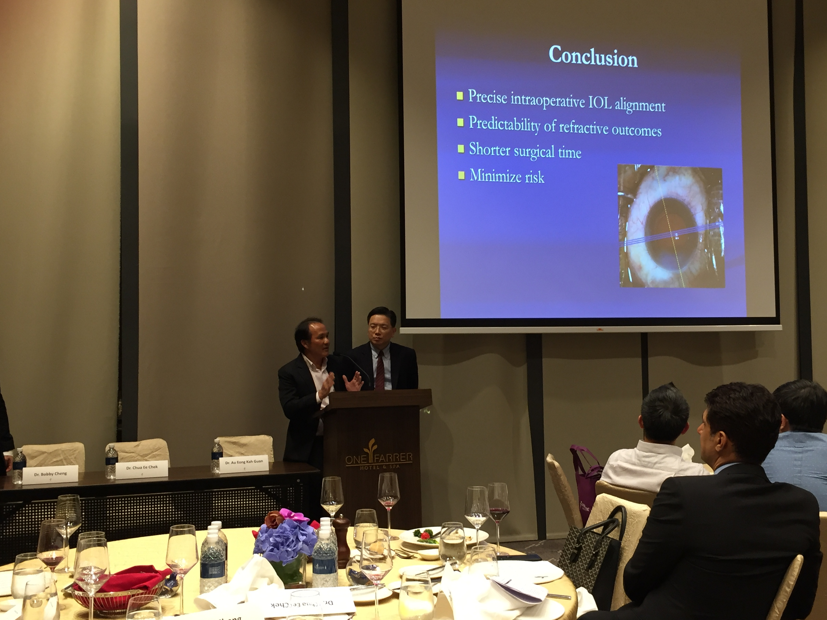 "Dr Chua Ee Chek (left) and Dr Au Eong Kah Guan engaging in a lively question and answer session with participants at the symposium on ""Advances in Computer-assisted Cataract Surgery"" at One Farrer Hotel & Spa on 2 August 2017."