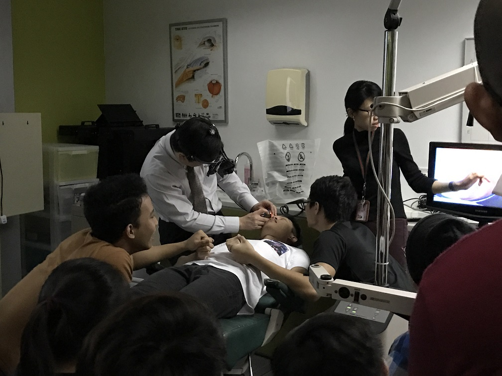 Dr Au Eong Kah Guan and Ms Jessie Tan Sze Hui demonstrating indirect ophthalmoscopy with a teaching binocular indirect ophthalmoscope to second year optometry students in Ngee Ann Polytechnic on 27 July 2017.