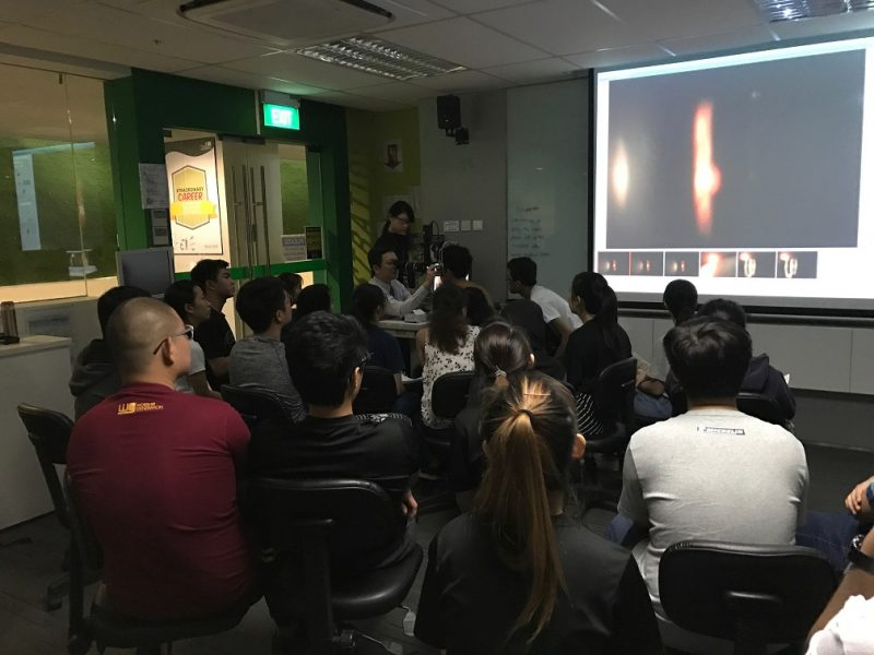 Dr Au Eong Kah Guan demonstrating the finer points of slit-lamp fundus examination to second year optometry students in Ngee Ann Polytechnic on 27 July 2017.