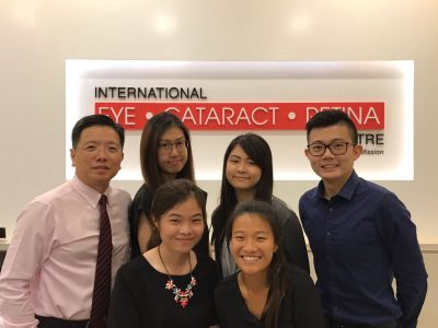 Ms Daphne Chiew (front row, right) with (back row, L-R) Dr Au Eong Kah Guan, Lee Hui Xin Leanne, Goh Jiah Ying, Chong Wee Hou and Ng Shu Yi (front row, left) in International Eye Cataract Retina Centre at Farrer Park Medical Centre.