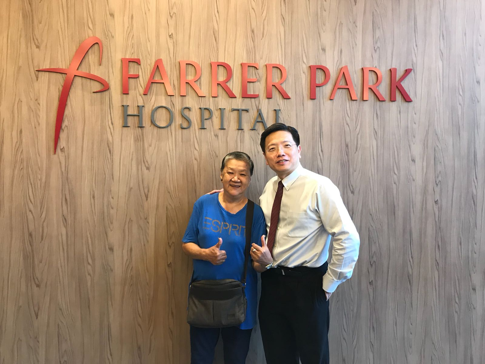 "Patient Madam Soi Soi (L) showing a gesture of approval for her surgeon Dr Au Eong Kah Guan after the ""Thank You"" lunch meeting in Farrer Park Hospital."