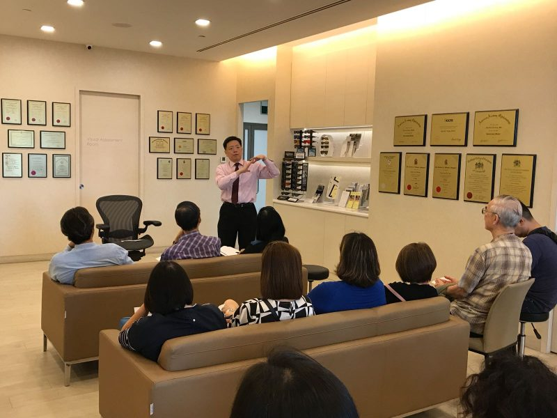 Dr Au Eong Kah Guan conducting a small group tutorial for optometrists and opticians in International Eye Cataract Retina Centre.
