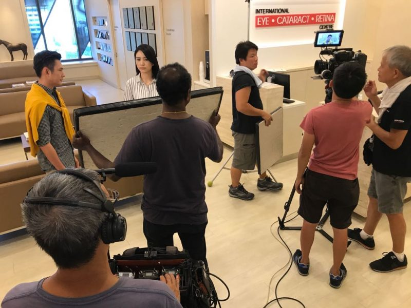 Actor Zen Chong (with yellow cardigan) and actress Sora Ma (in striped blouse) shooting a scene for the new TV series  in International Eye Cataract Retina Centre at Farrer Park Hospital.
