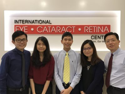 Chong Wee Hou (left), Goh Jiah Ying (second from left), Ng Shu Yi (second from right), Dr Au Eong Kah Guan (right) and I (Tham Zhi Wen Winston)(centre) at International Eye Cataract Retina Centre.