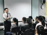Dr Au Eong Kah Guan (standing) sharing tips and pearls from his experience with first year optometry students at Ngee Ann Polytechnic.