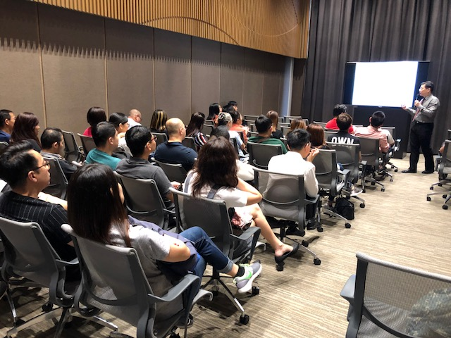 Dr Au Eong Kah Guan giving his lecture on ocular complications of pathological myopia to practising optometrists and opticians at a Continuing Professional Education programme in Farrer Park Hospital on 3 May 2018