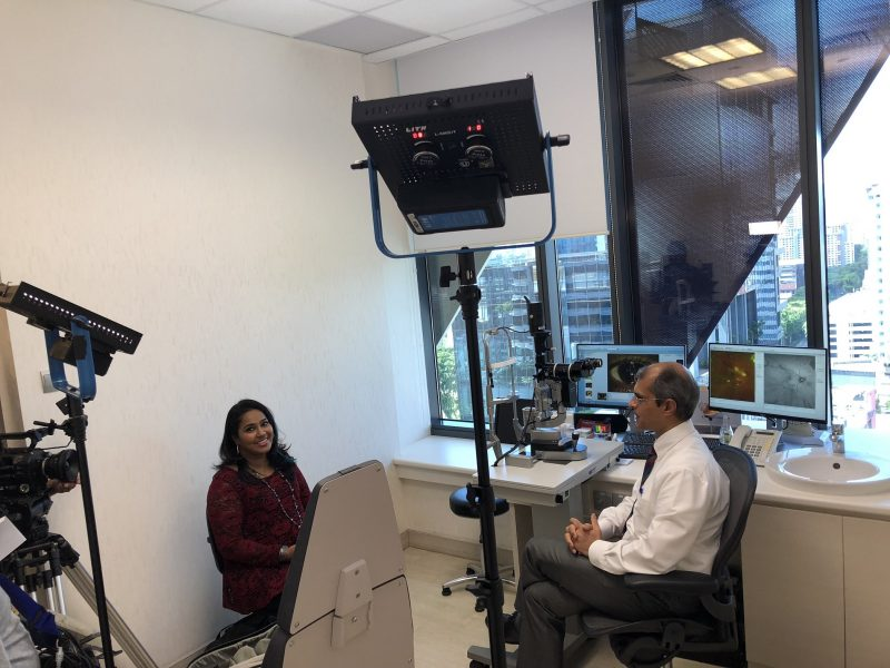Mediacorp Vasantham interviewer Ranni Kanna (L) and Dr Ajeet Madhav Wagle (R) during filming for the television programme