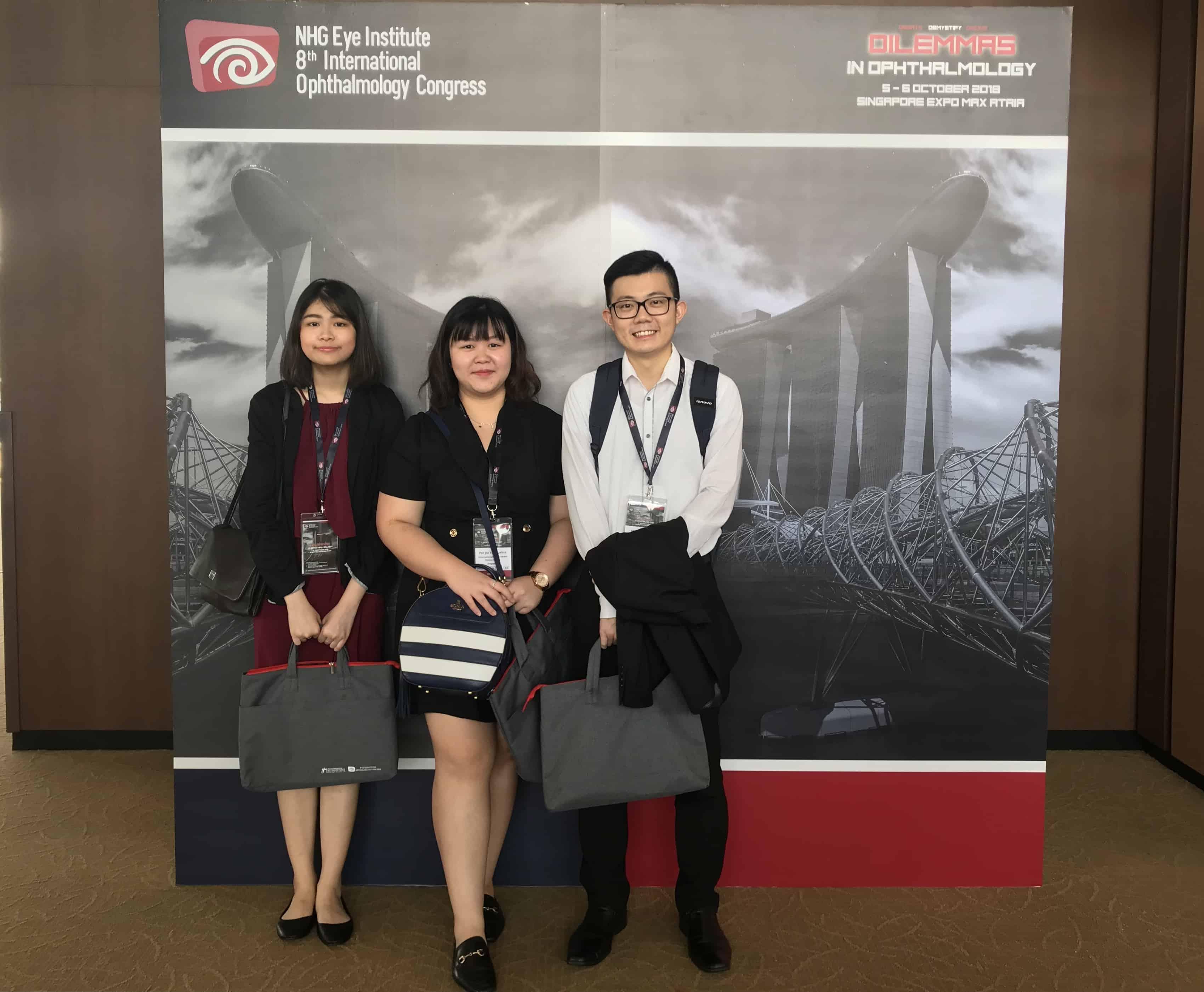 International Eye Cataract Retina Centre optometrists (L-R) Ms Goh Jiah Ying, Ms Por Jia Yee Davina and Mr Chong Wee Hou at the 8th International Ophthalmology Congress in Max Atria, Singapore Expo on 5-6 October 2018